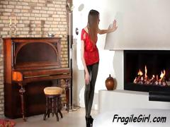 Skinny Young Brunette Teen Poses And Does A Strip Dance In Front Of The Fireplace