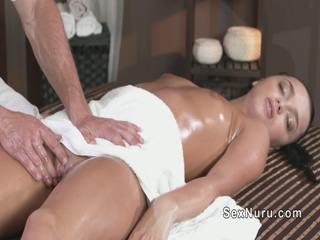 Oiled babe wanks and fucks masseur