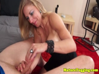 Mature milf gets cum in eye and on tits