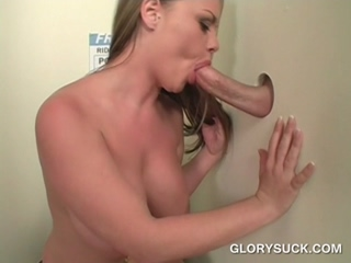 Big butt cutie blowing cock with lust on gloryhole