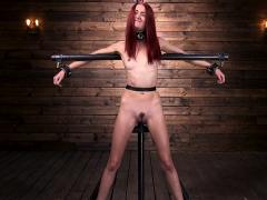 Skinny Redhead Slave Whipped In Device Bondage