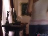Niki Blond walks into a living room