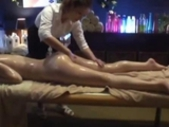 Asian Girl Massaged With Oil Getting Her Hairy Pussy Fingered On The Massage Bed